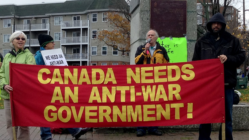 Allan Bezanson (centre) speaks at the protest under the statue of Edward Cornwallis.