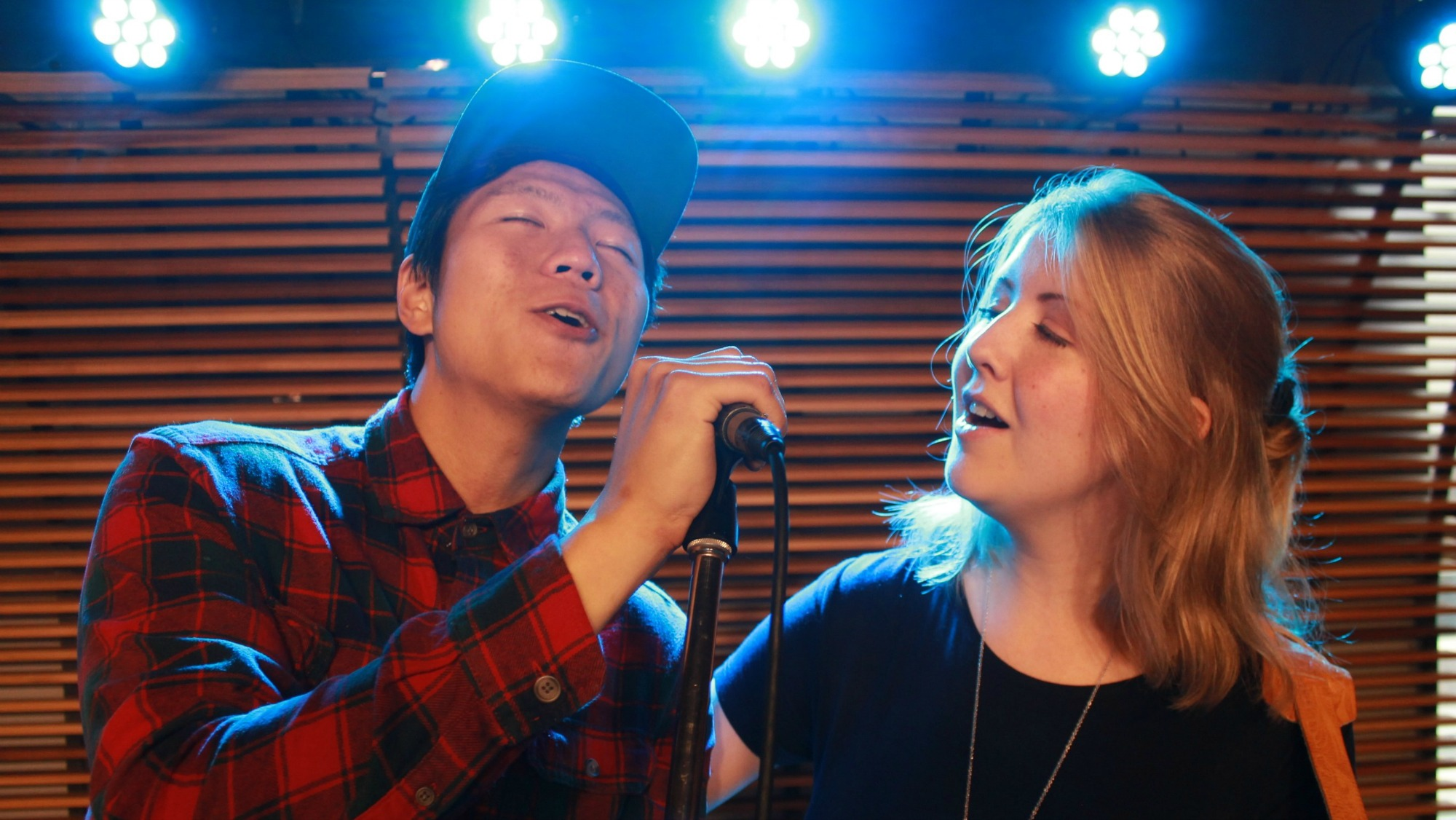 Grawood open mic hosts, Uytae Lee and Claire Attridge, share the stage at the weekly Dalhousie event.
