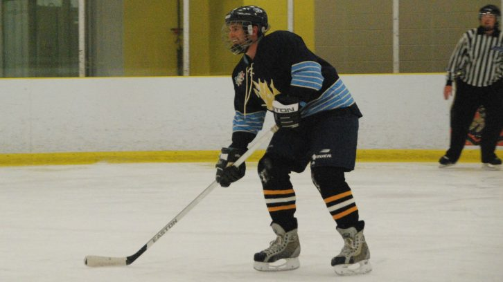 Matt Walters is all smiles on the ice as he waits for a pass from a teammate Walters plays for the Halifax Co-Ed Hockey League Privateers