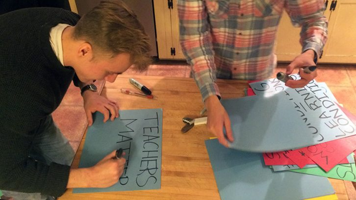 Students make posters after school to prepare for Friday's rally.