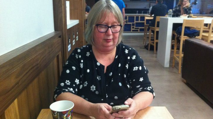 Pam Sword, Local Xpress editor, is never far from her phone to connect with colleagues from her digital newsroom