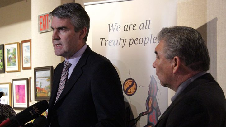 Premier Stephen McNeil and Glooscap Chief Sidney Peters speak with reporters at the Nova Scotia Archives.