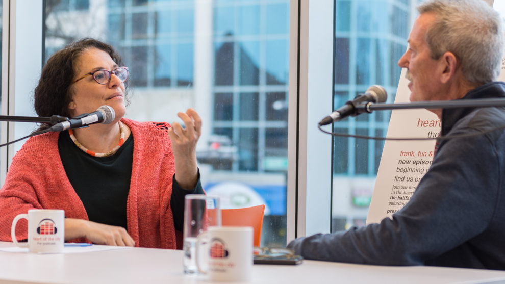 Tova Sherman (left) with guest Bruce Mills at a recording of the HOT City Podcast.