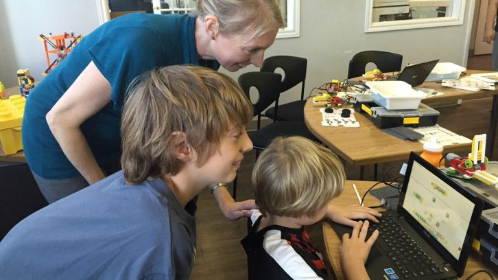 Kids learn to code robots during a class at Sylvan Learning Centre