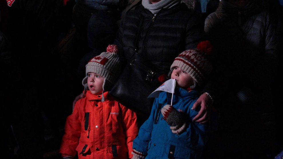 Maxwell and Gavin Prole stand with their grandmother mesmerized by the live performance by the Octonauts.