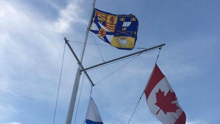 The official flag of The University of King's College flies at the top of the campus's flag mast