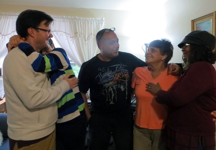Lopez, Peña, and Williams together with Peña's son in her apartment.