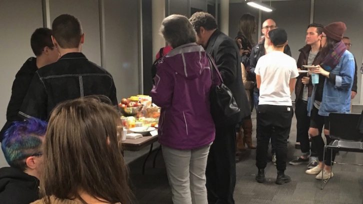 Attendees of the TDoR gather around for refreshments afterwards.
