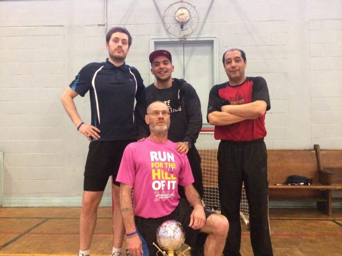 Nick, Randy, Moe and Jabar celebrate their Halifax Street Soccer championship victory.