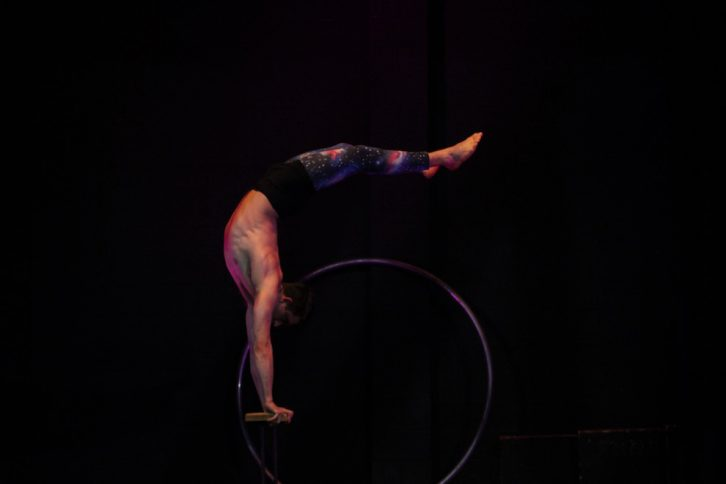 Smith performs his act on the cane bars.