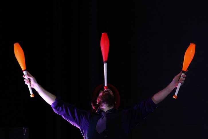 Danger balances a club during the juggling routine.