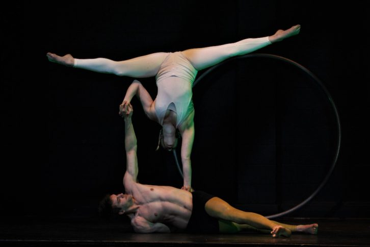 Alex Smith and his partner Cait perform and acrobatic act.