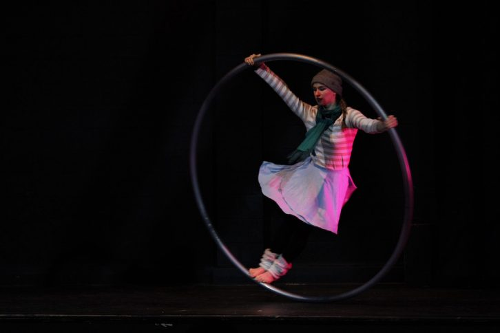 Christine Conrad takes a spin in the cyr wheel at the Friday show.