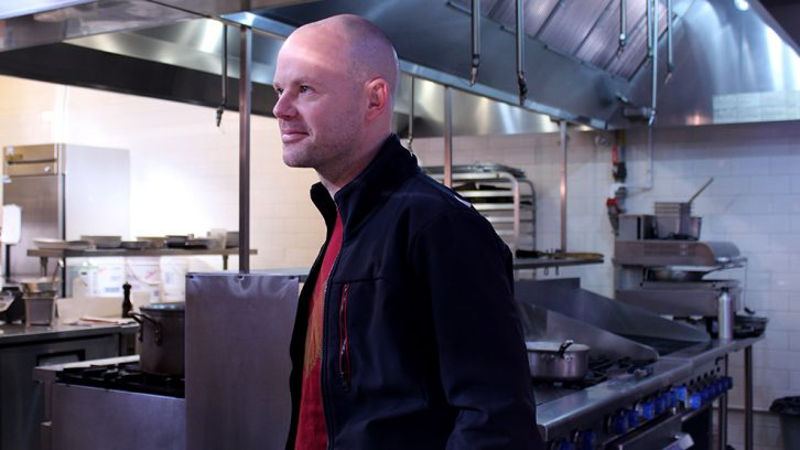 Ludovic Eveno surveys the kitchen at the Agricola Street Brasserie.