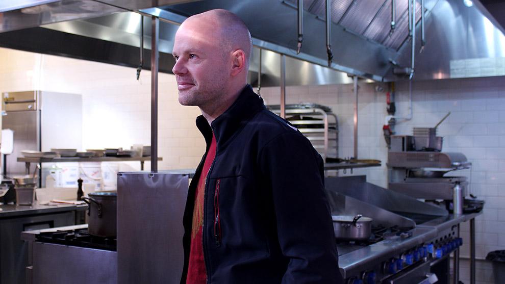 Ludovic Eveno surveys the kitchen at the Agricola Street Brasserie.
