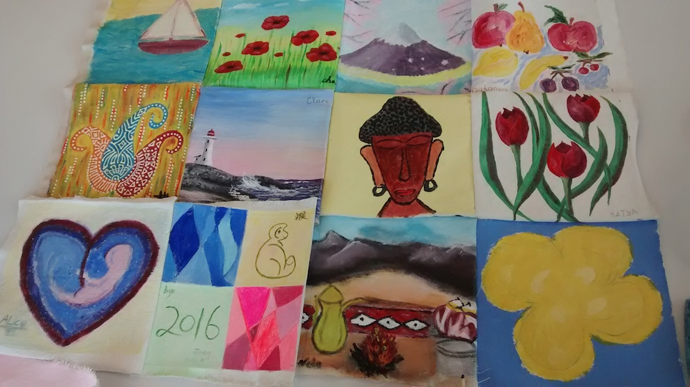"""A canvas quilt made by the members of the """"Art of Belonging"""" workshop."""