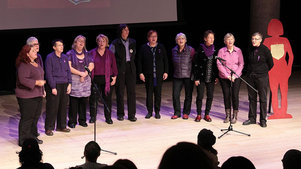 Women Next Door a cappella group performs.