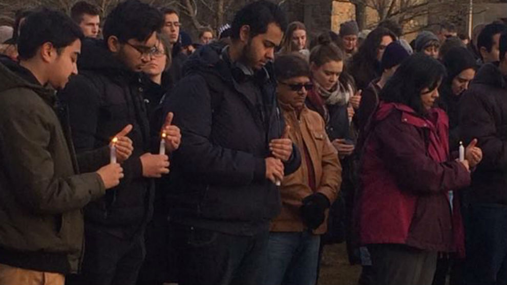 People holding candles at the vigil on Dalhousie campus