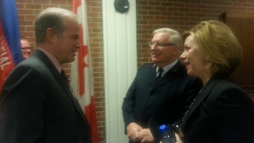 Service Nova Scotia Minister Mark Furey (left) talks with Major Wade Budgell of the Salvation Army (centre) and Nova Scotia Power CEO Karen Hutt (right).