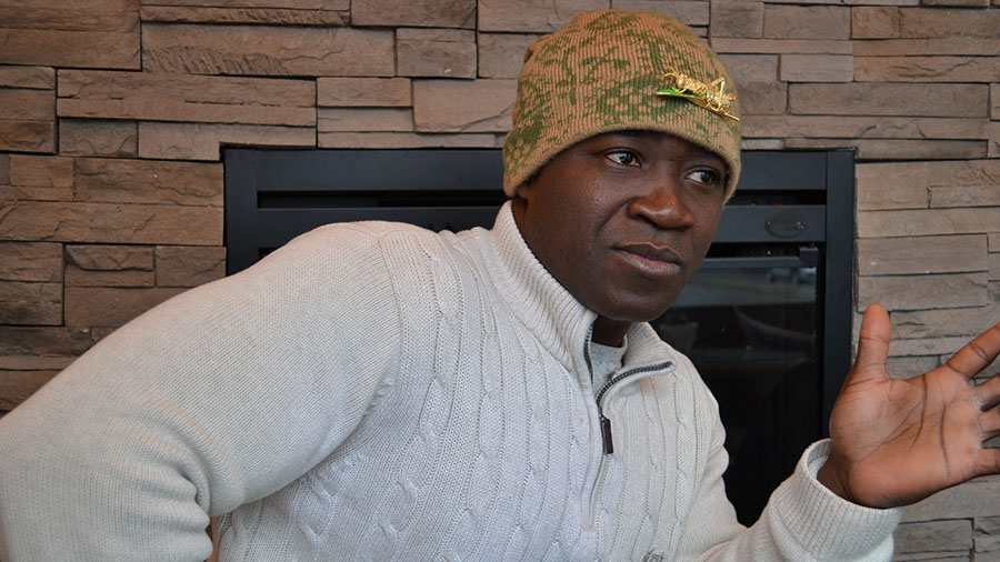 "Amoateng sporting a golden brooch of his namesake - ""grasshopper"""