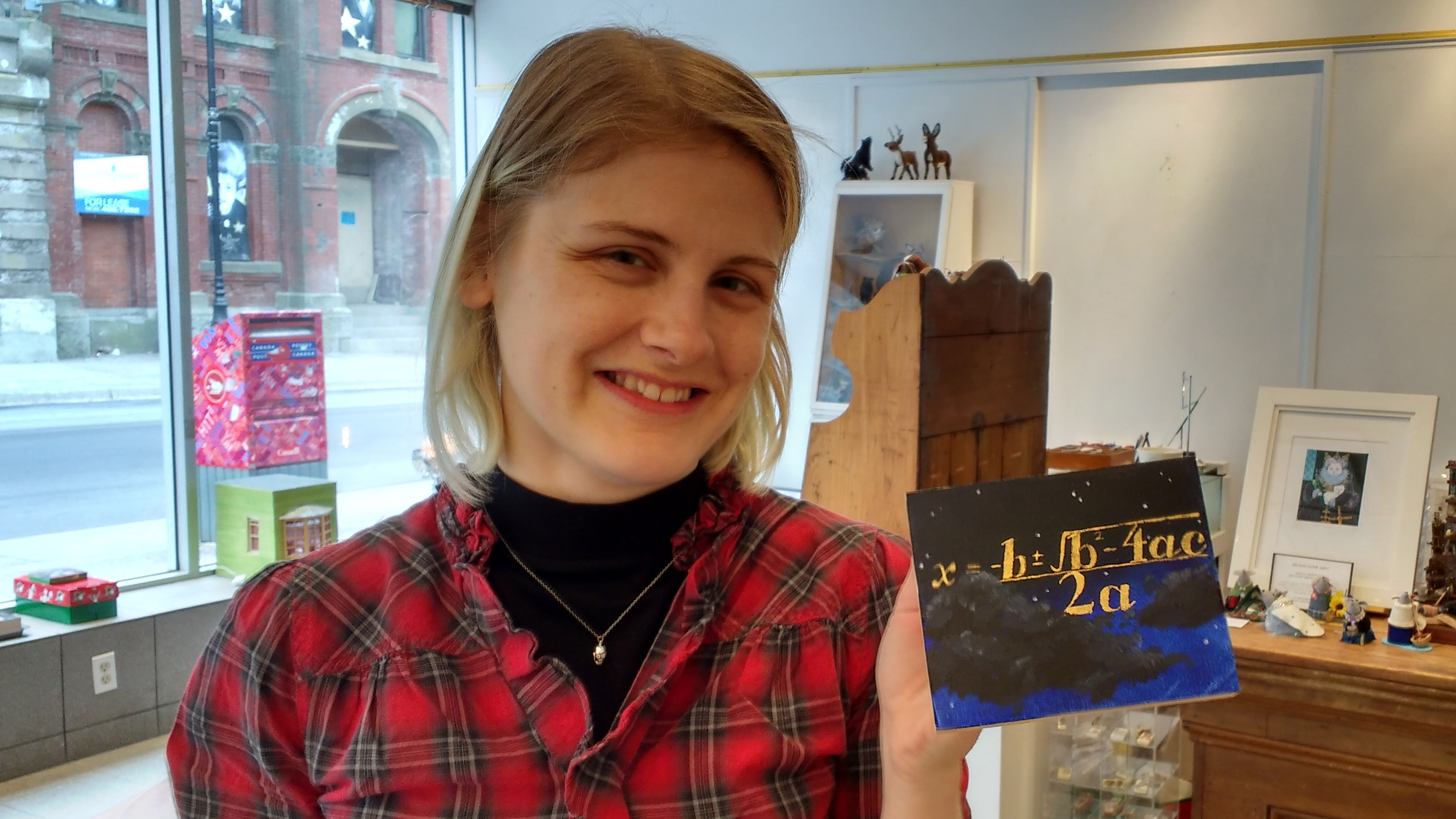 Caitlin McGuire, gallery assistant, holds up her favourite tiny piece.