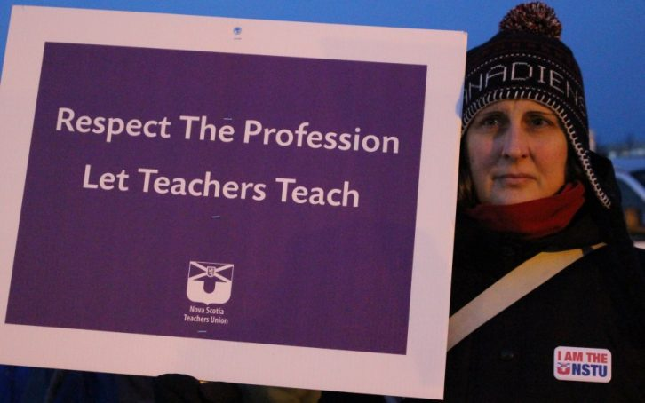 A protester from Monday night's NSTU rally.