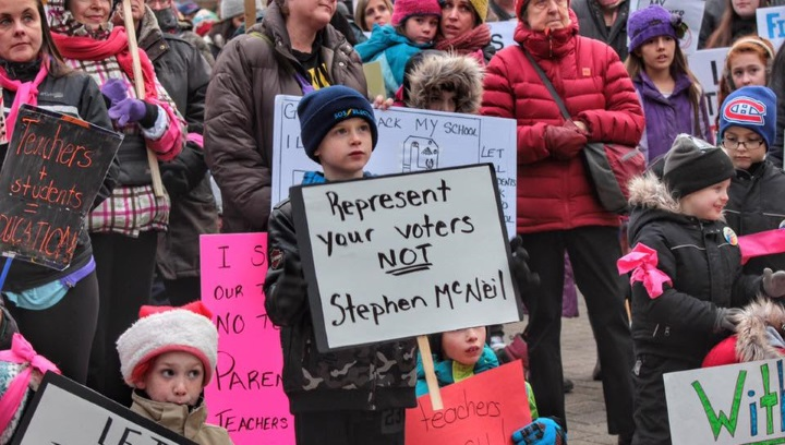 Parents and students march in protest of the provincial government in December.