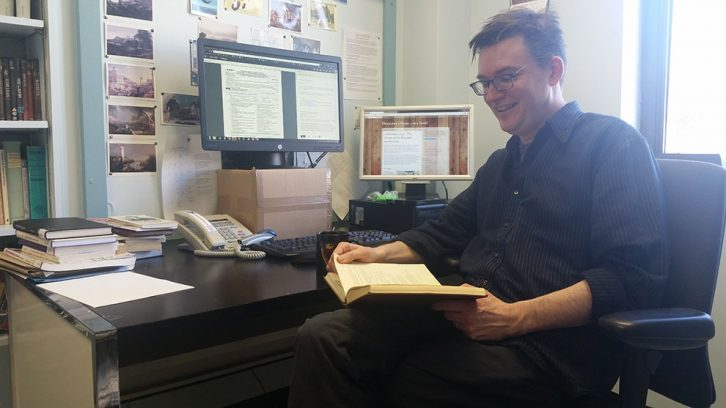 David Nicol skims through Philip Hensolwe's diary, a rare artifact from Elizabethan England