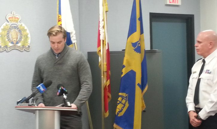Halifax Pride Executive Director Adam Reid addresses reporters with with Halifax Regional Police Chief Jean Michel Blaid