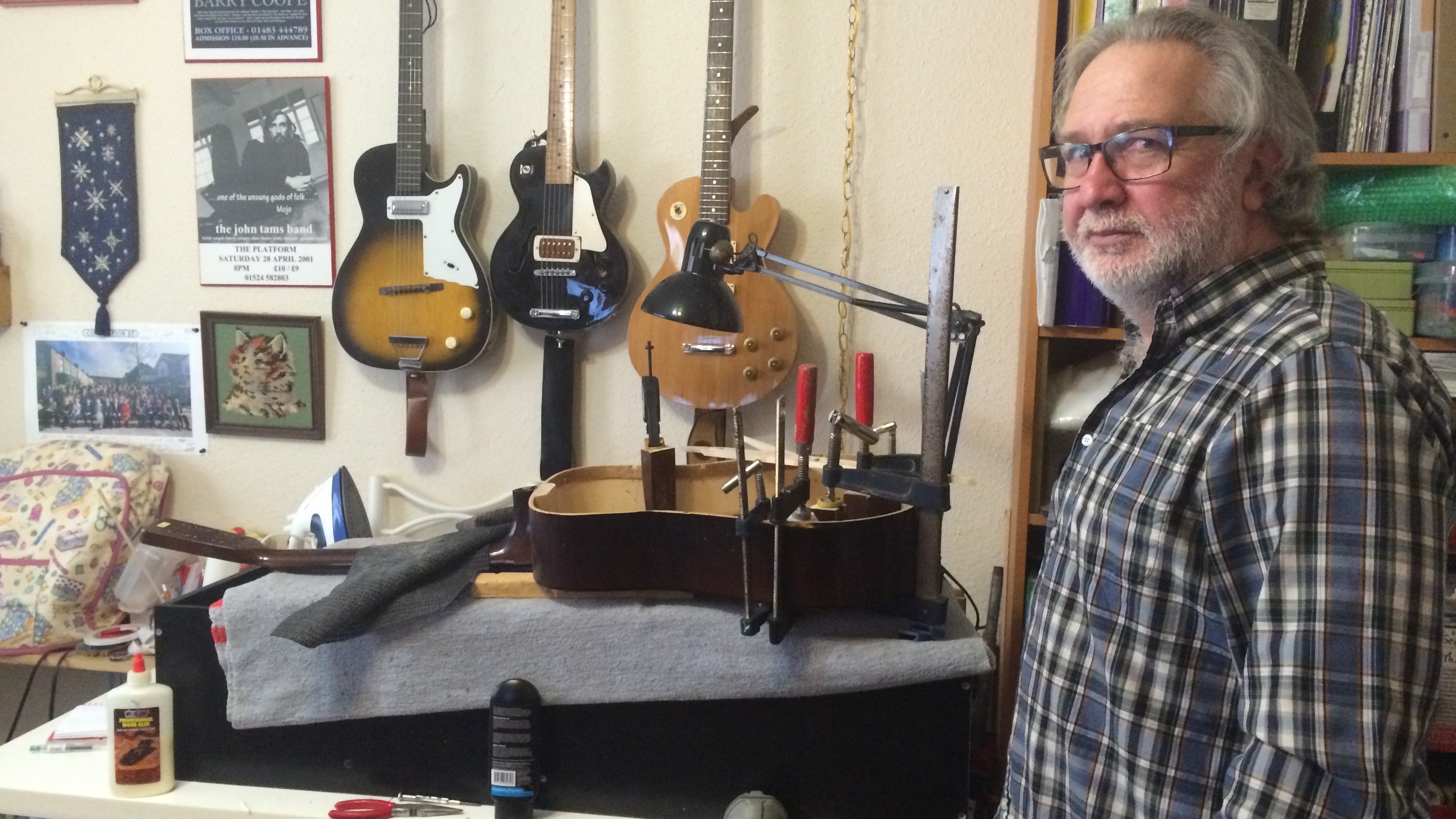 Calvert Lewis spends his free time collecting and fixing guitars to donate to Guitars for Vets