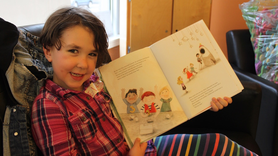 Elliott reads from one of their favourite books <i>Morris Micklewhite and the Tangerine Dress<i>