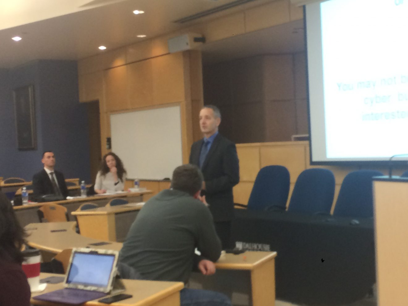 Gary Brown (standing) speaks during the annual International Humanitarian Law conference at Dalhousie on January 27.