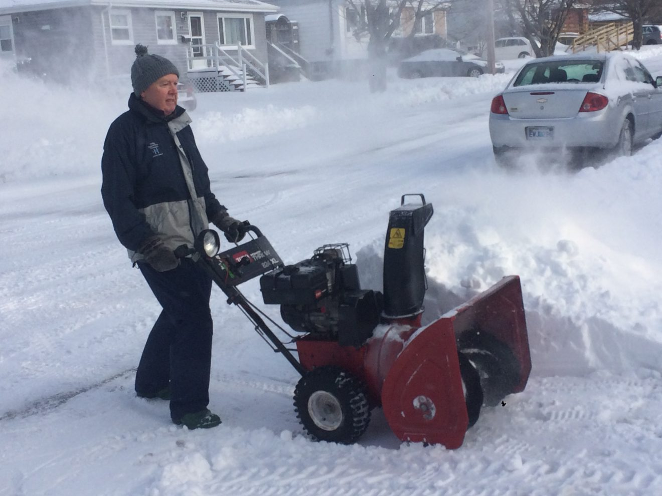 Wendell Coveyduc uses a snowblower to clear his driveway on Friday after the second snowstorm to Halifax in less than a week.