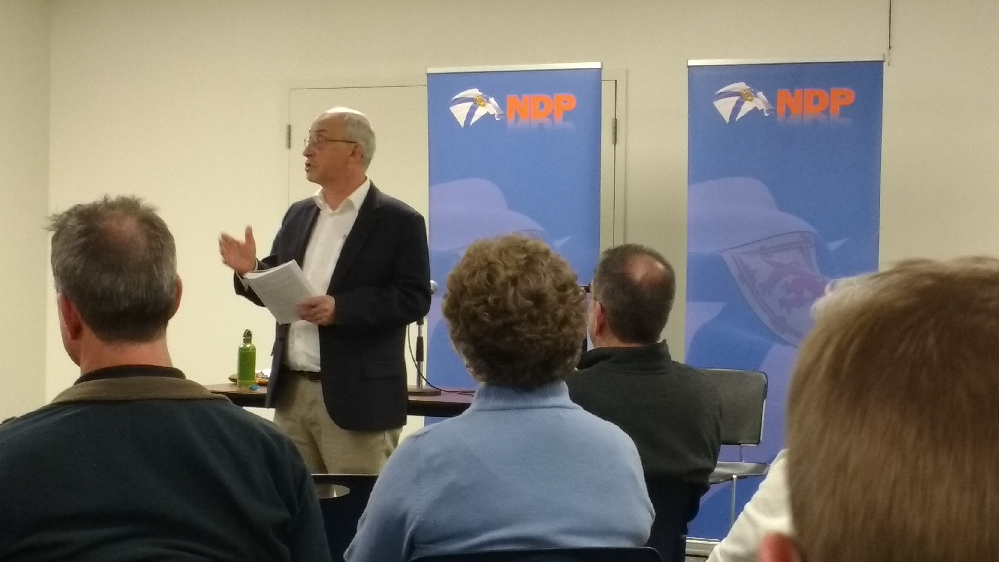 Gary Burrill, leader of the NSNDP, speaks and reads from the new policy book at the launch.