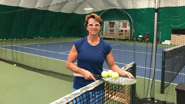Marijke Nel stands by the net at the HEADStart Tennis Club in Clayton Park.