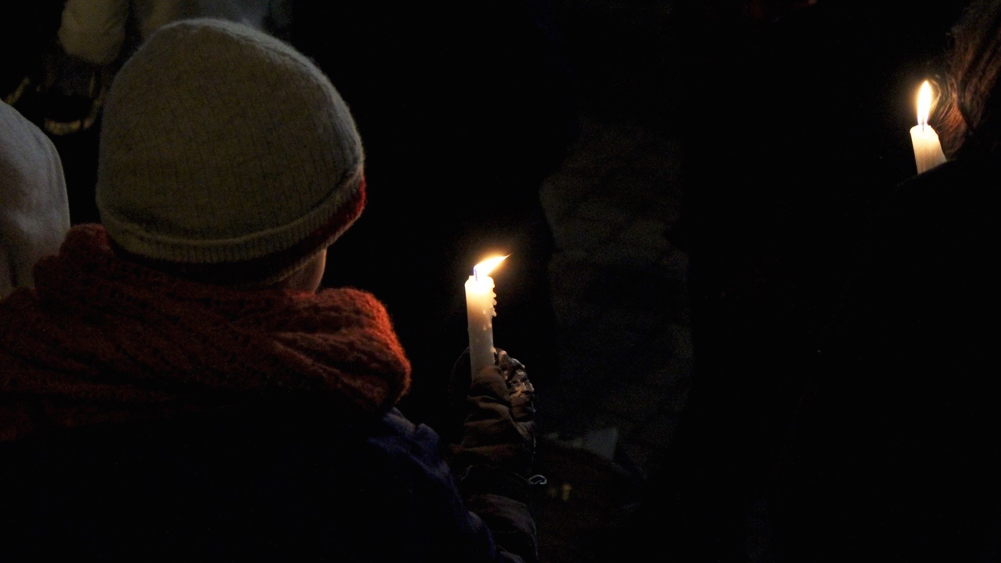 A young attendee holds a candle at the Halifax vigil for the Quebec mosque shooting.