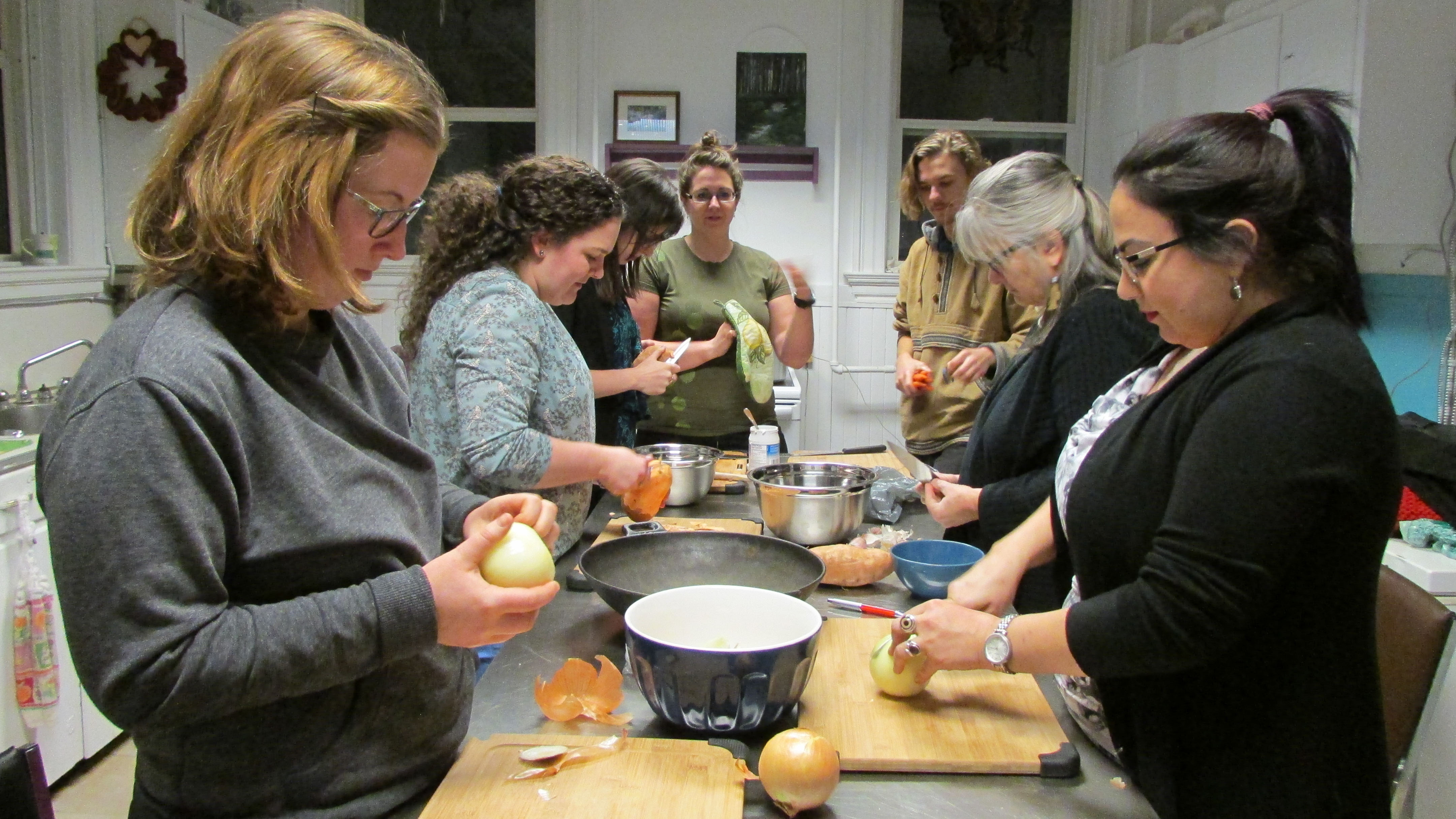 Everyone gathered around a tiny table and began preparing Massaman curry at a Halifax Trade School workshop.