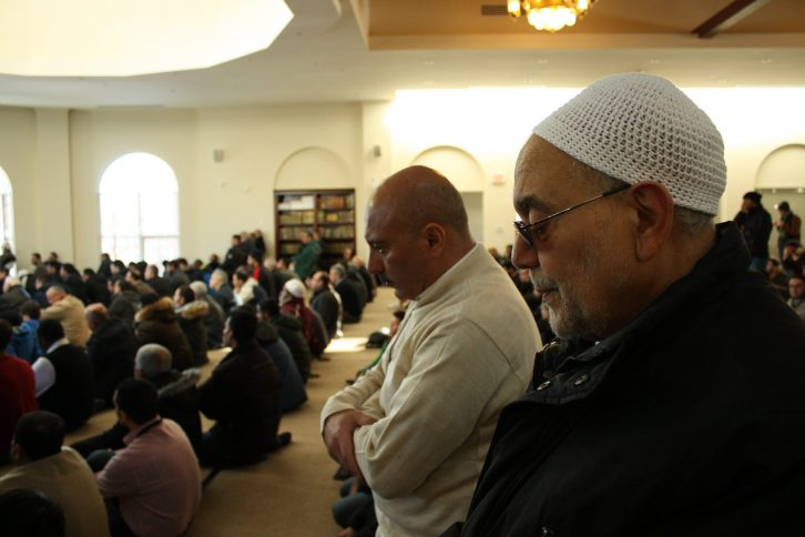 Two men praying at Ummah Masjid