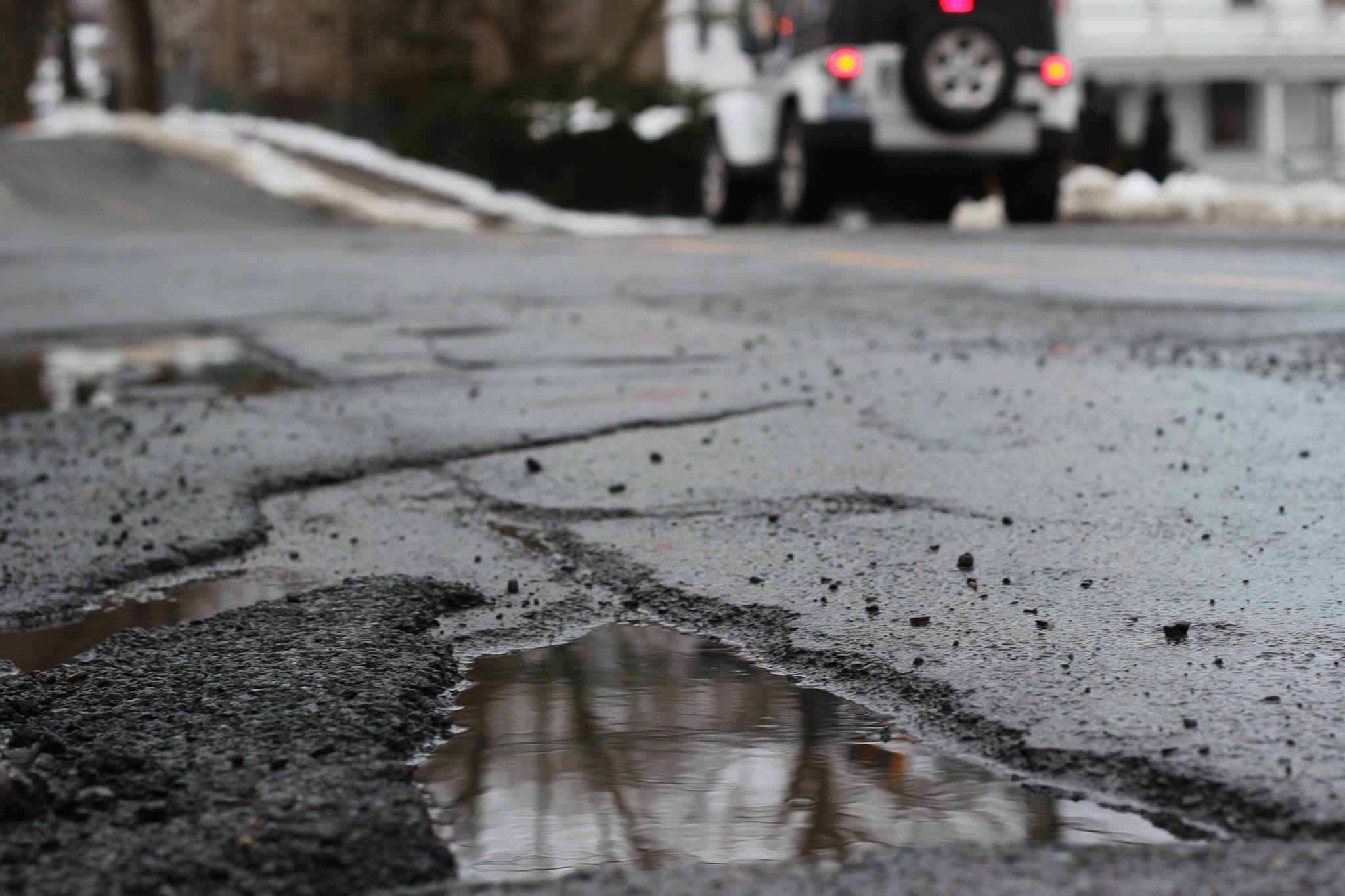Potholes are created by fluctuation in temperature and wear and tear from snow-clearing equipment.