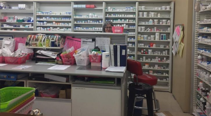 Maria Tasiopoulos working the pharmacy counter at Lawaton's drugstore at Robie and Spring Garden