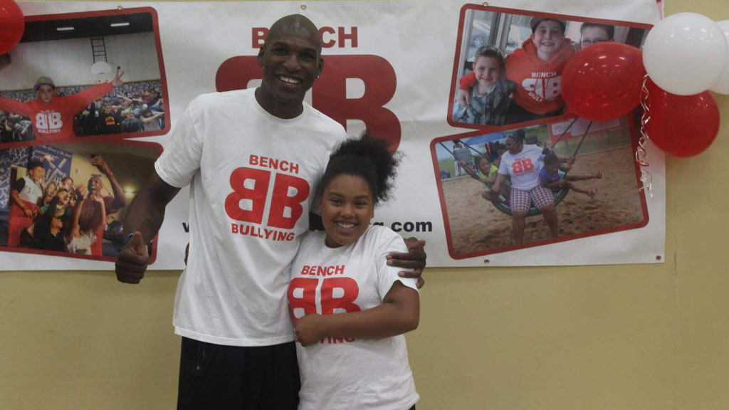 Bench Bullying founder Eric Crookshank poses with one of the students he's met.