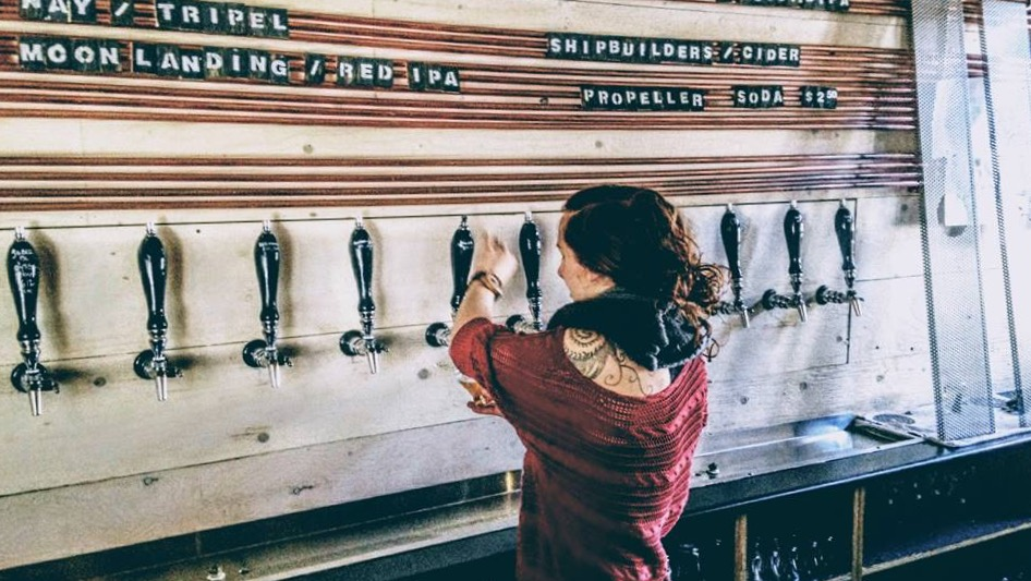 Erica Fraser, an employee at Good Robot Brewing Company, pours a sampler.