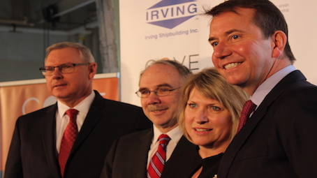 (From left) Kevin McCoy, Jim Hanlon, Kelly Regan and Scott Brison pose for photos after announcing the investment.