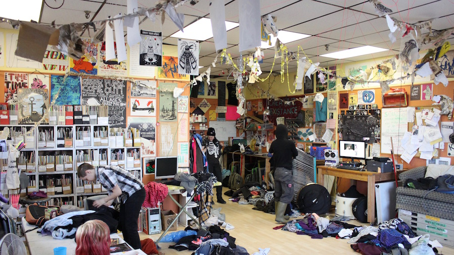 People quietly pick through the piles of clothes at Radstorm's clothing swap on Saturday.