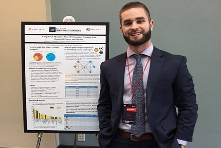 Shael Brown stands in front of his research poster at the MIT Sloan Sports Analytics Conference in Boston.
