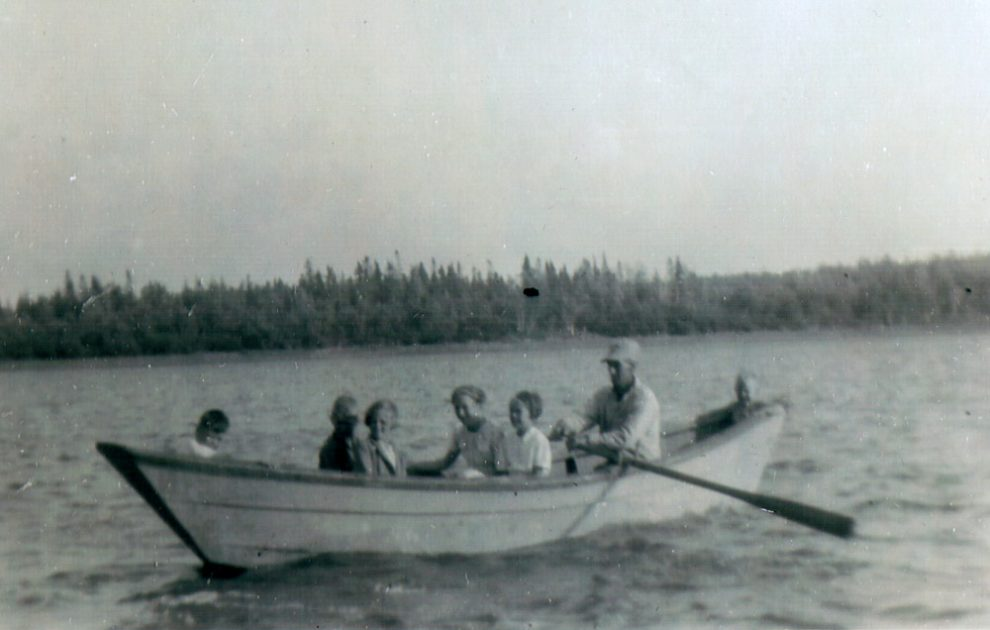 A photo taken in the late forties of Doug Mackay's neighbours, the Frasers, rowing in Boat Harbour.