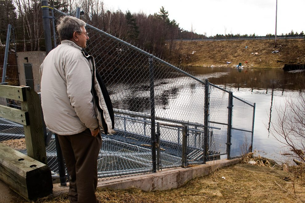 Bob Christie looks at the dam which replaced a bridge leading into the lagoon.
