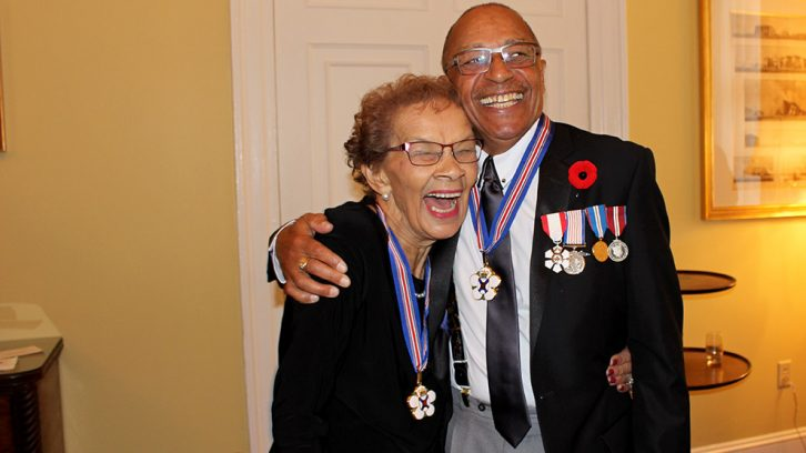 Geraldine Browning (left) and Brad Barton (right) share a laugh after becoming members of the Order of Nova Scotia