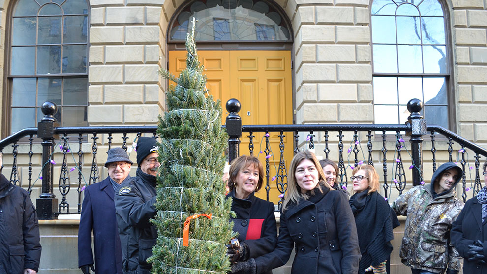 Tammy Turple (right) receives a Christmas tree from Deputy Premier Karen Casey.