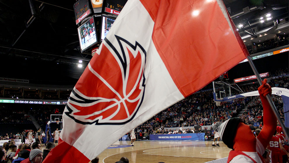 """Captain Canada"" waving the Canada Basketball flag in the Scotiabank Centre."
